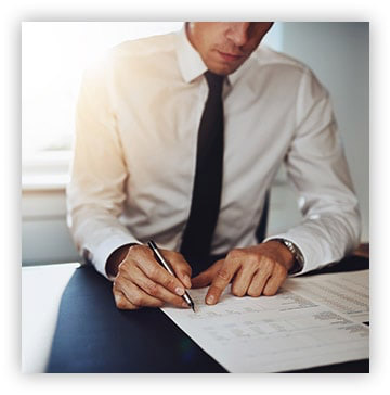 man reviewing business documents