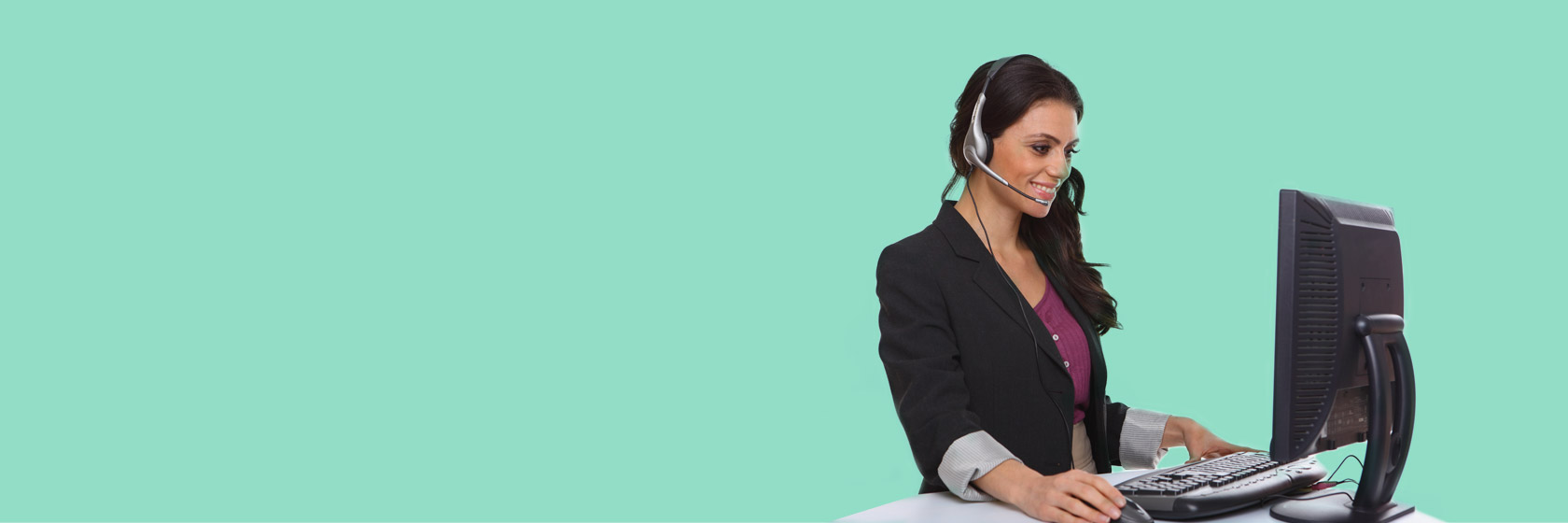 Call agent smiling on computer